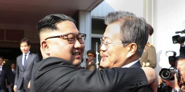 north korean kim jong un meets againn south korea s moon