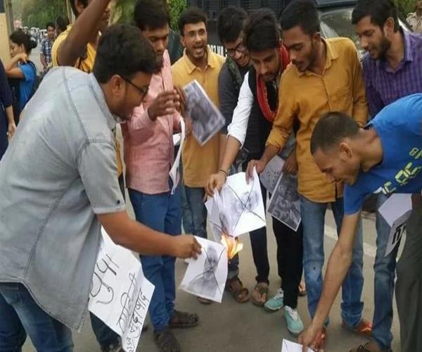 photos of modi yogi burnt in pm s parliamentary constituency