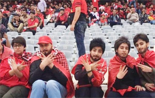 women in iran watch football match photo viral with a bearded mustache