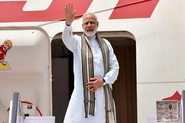 modi focus on defense relations during indonesia singapore visit