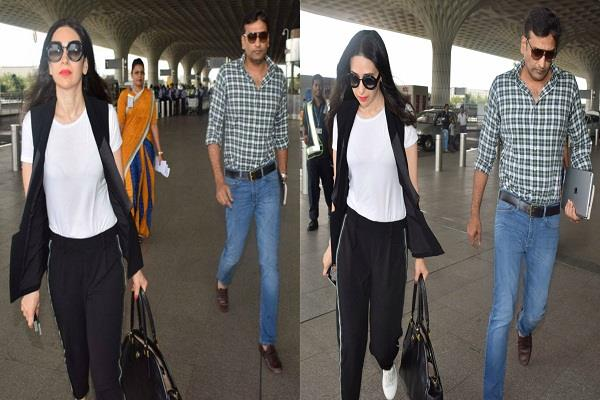 karisma kapoor spotted with sandeep toshniwal at airport