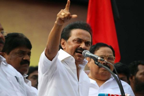 dmk questioned on karnataka governor action