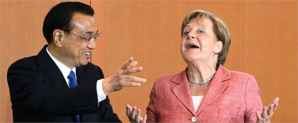 merkel in china stresses dialogue on human rights tech
