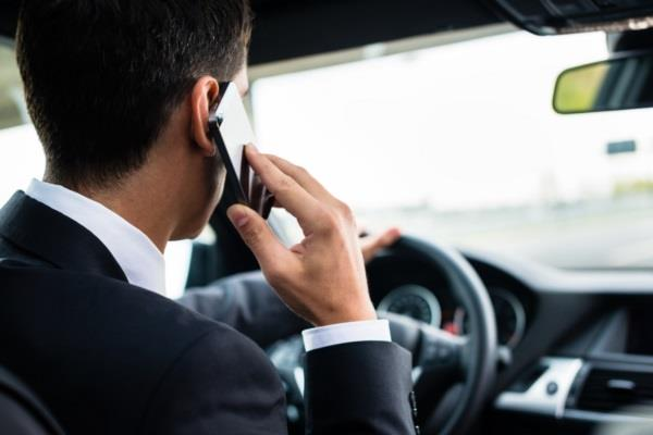 talking on the phone while driving is not a crime kerala hc