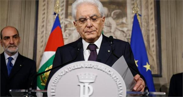 italy s president asks former imf economist to form government