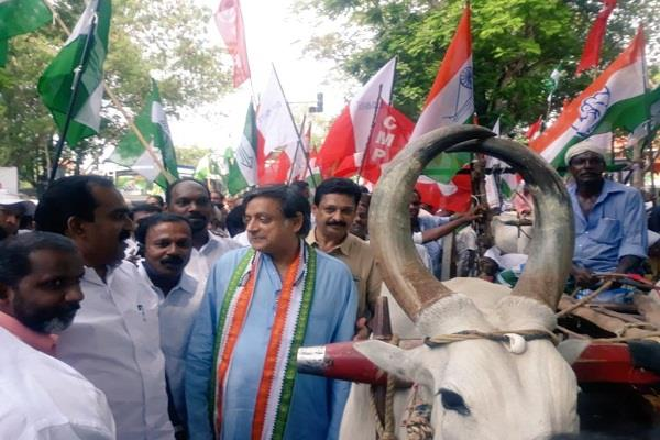 on the bullock cart shashi tharoor opposes the rising prices of petrol