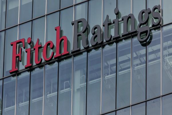 fitch reduces axis bank icici bank rating