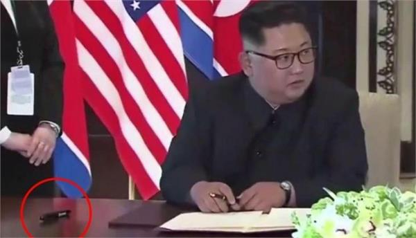 trump kim summit kim security wiped down us pen for signing ceremony