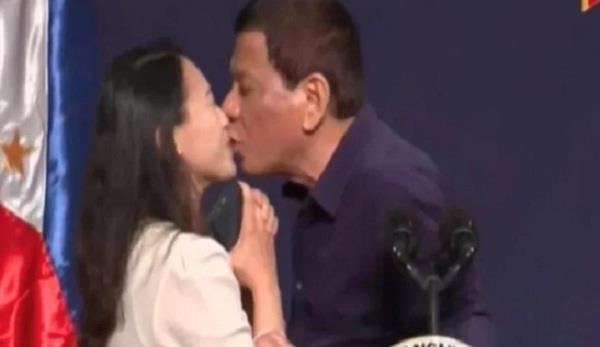 philippine president criticised for kissing woman on stage