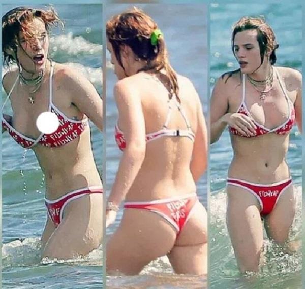 bella thoran s slipped bikini while enjoying the sea with the boyfriend