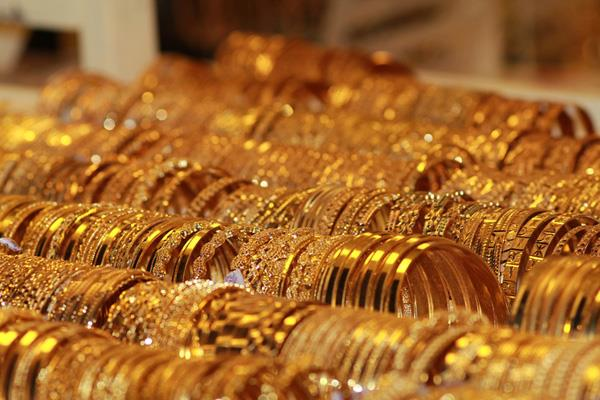 gold stays weak on global cues low demand
