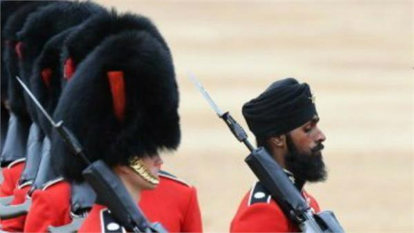 sikh soldiers will become first person to wear turban at  truking the color