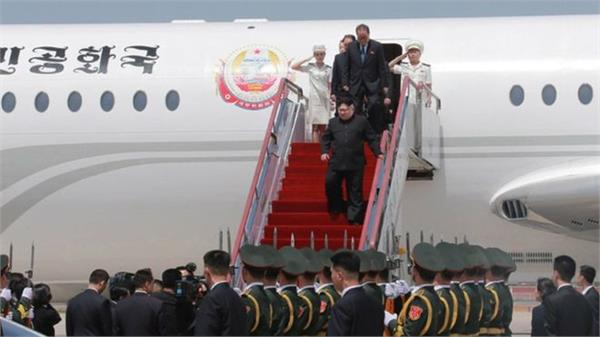kim lands in singapore ahead of summit with trump