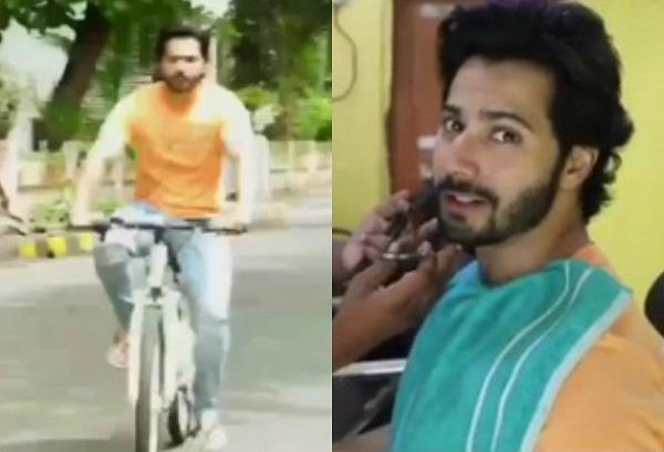 varun dhawan arrives at the local saloon on the bicycle
