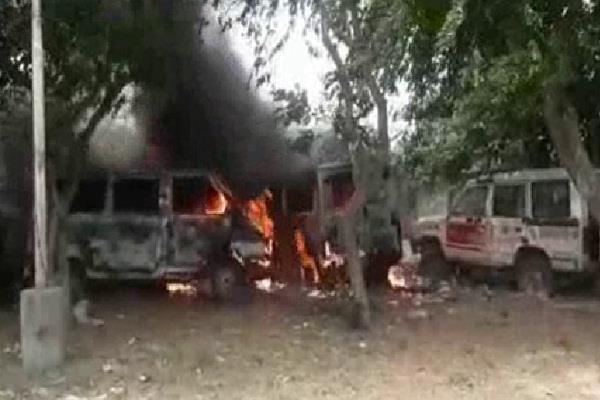 burning half dozen ambulances standing outside the hospital