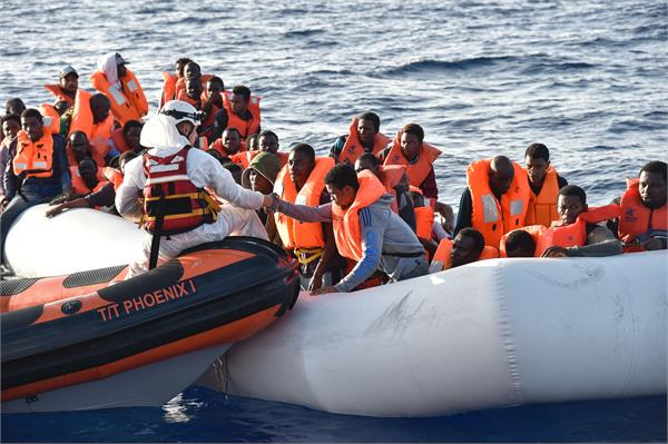 more than 300 refugees rescued from libya and italy