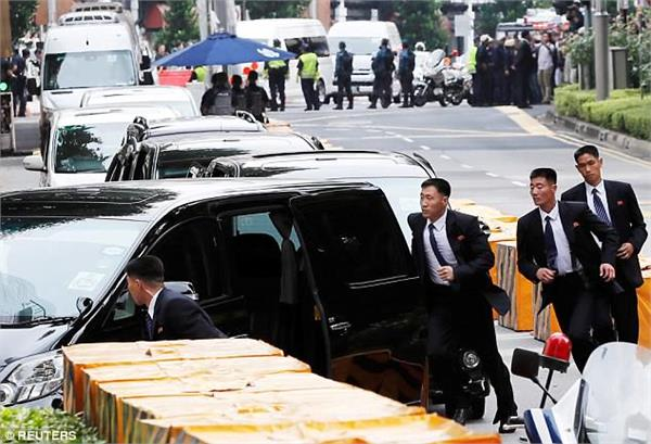 trump kim summit kim jong bodyguards jog by car ahead in singapore