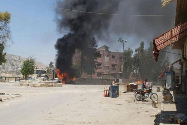 at least 18 deaths in car bomb blast in eastern syria