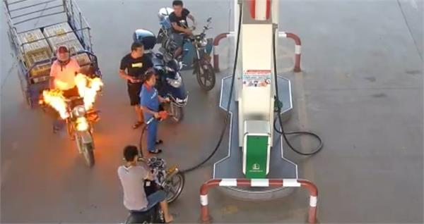 chinese gas station puts out fire from motor tricycle