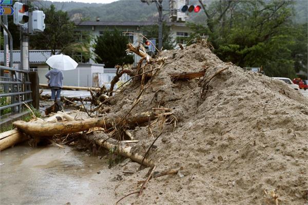 heavy rains in japan 38 dead 50 missing