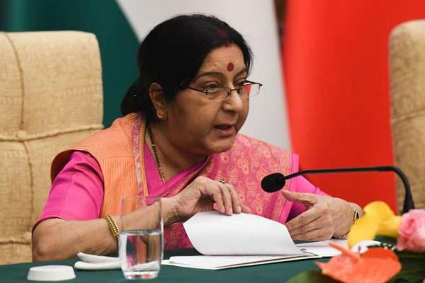 sushma says now will be strict action against nri