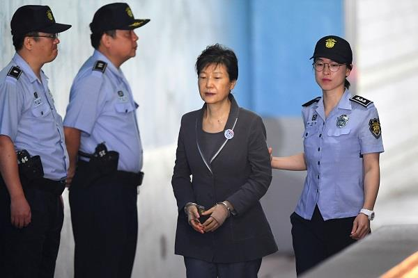 former korea president and sentenced to 8 years of imprisonment