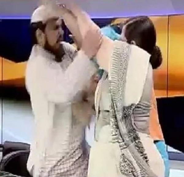 maulana arrested for assaulting woman during live show