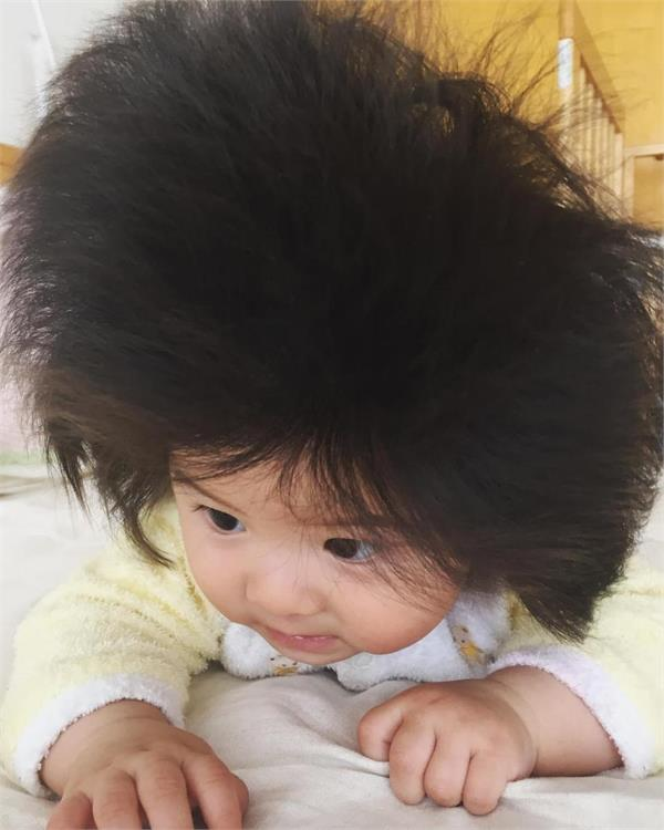 baby girl with huge hair has 40 000 instagram followers