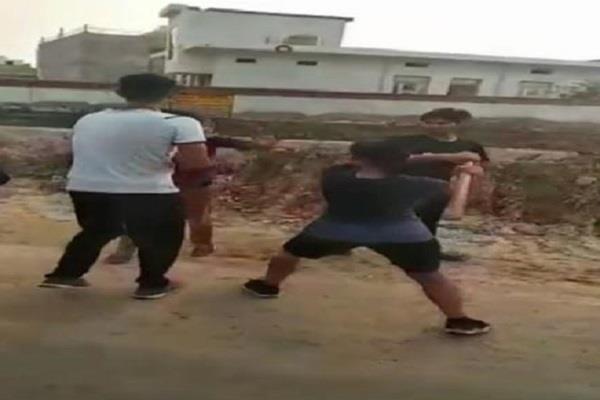 girl beats a boy with a stick