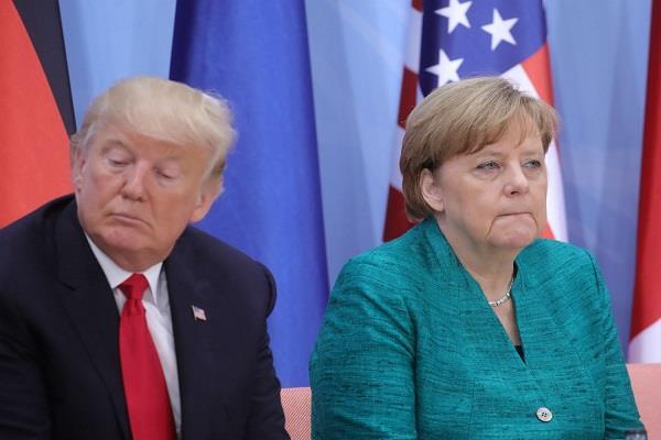 merkel warns trump about trade war
