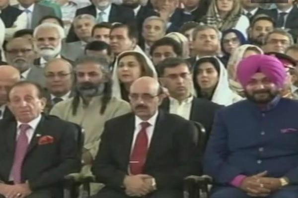 sidhu sitting next to the president of pok