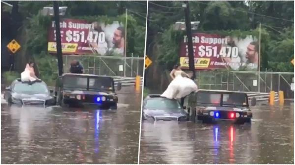 us cops rescue bride stranded on top of car in flood water