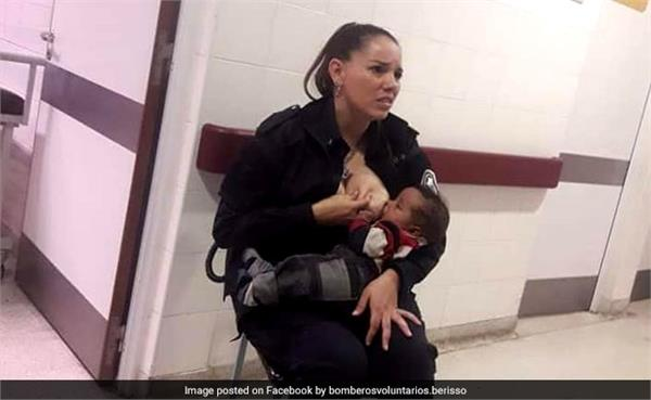 argentina police officer breastfeeds malnourished baby in viral photo