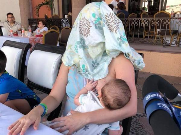 breastfeeding mom cover her face picture goes viral