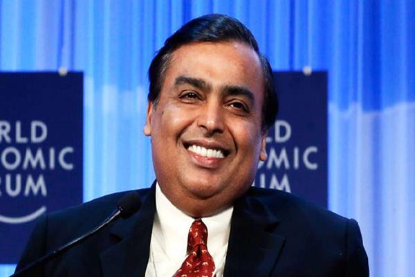 mukesh ambani s assets cross  50 billion
