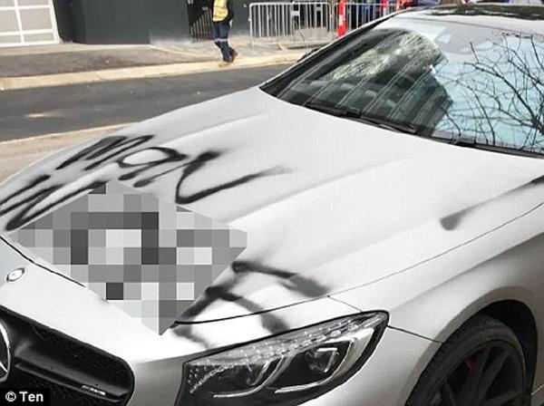 women s written abuses on a 2cr car then broken by the bat