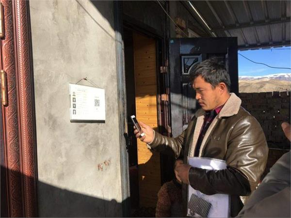 china installing qr code outside uighur muslim s home