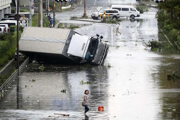 hundreds injured in storm surge in japan