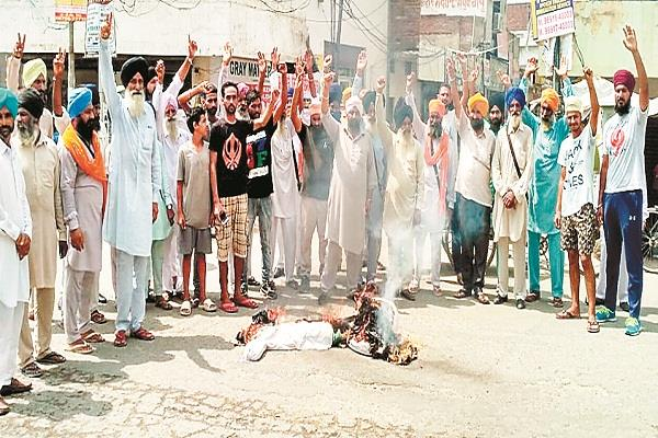 people from badhni kalan took out rage march