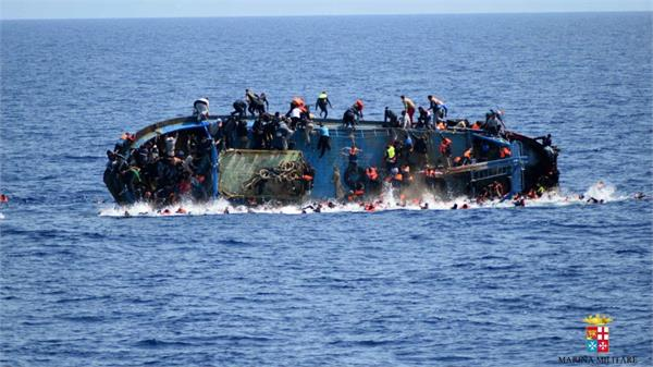 migrant crisis scores drown off libyan coast