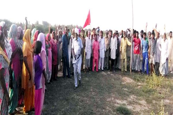 farm workers congratulate the village on the panchayat land