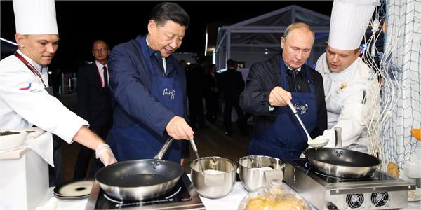 putin treats china s leader to pancakes vodka at forum