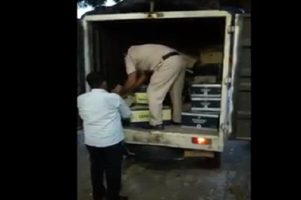 viral video of the police raising liquor bottles and boxes from the contract