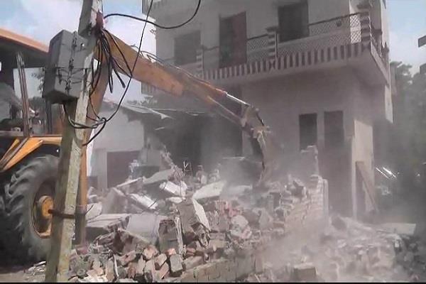 corporator s bulldozers run on illegal encroachment on highway nhai officials
