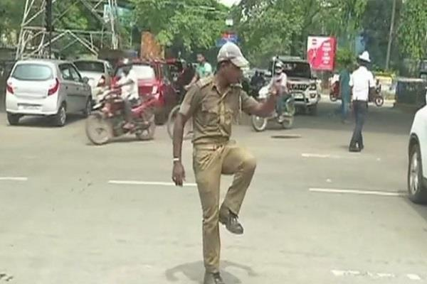 home guard controls traffic by his dance moves