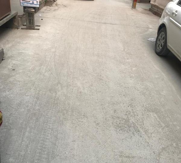 fly ash coming out of the newly built concrete road