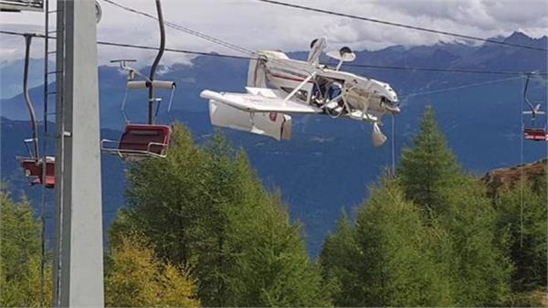 plane left entangled in ski lift cables in italy