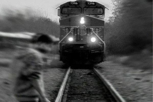 the young man jumped in front of the train