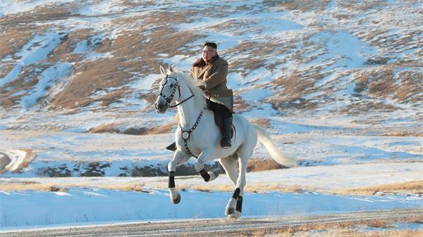kim vows to fight us sanctions visits sacred n korean peak