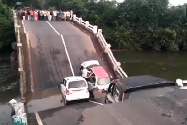 many cars damaged after a bridge collapsed in junagadh